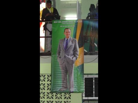 A poster with the image of former prime minister, Edward Seaga, emblazoned on it, at the recent Revival table set up in his honour inside the community centre in Tivoli Gardens.