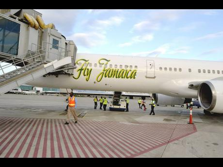 A Fly Jamaica aircraft is seen being prepared for flight in this 2013 file photo.