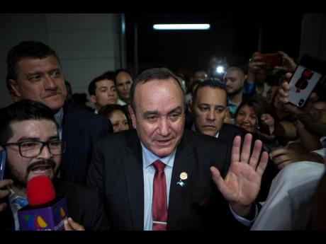 Alejandro Giammattei, presidential candidate of the Vamos party, arrives to the Electoral Supreme Court headquarters for interviews with the press after partial election results were announced in Guatemala City on Sunday.