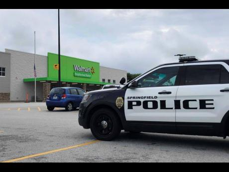 A police car turns into the parking lot at a Walmart store in Springfield, Missouri.