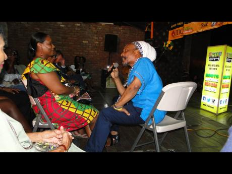 Yasus Afari in an interactive moment with a patron.