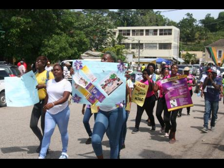 Staff members of the Hanover Health Department marching in Lucea yesterday.