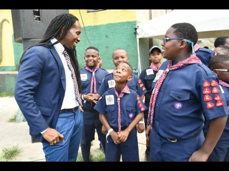 Minister of State in the Ministry of Education, Youth and Information, Alando Terrelonge (left), interacts with Cub Scouts from the Scout Association of Jamaica at the opening ceremony for the 15th Caribbean Cuboree, held recently at the Ocho Rios High School in St Ann.