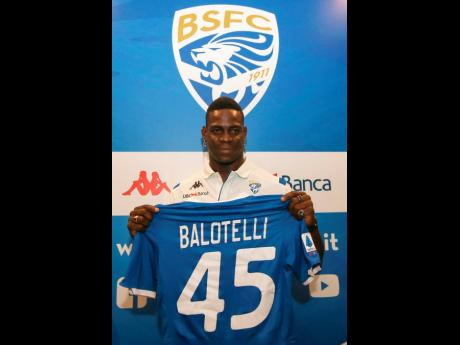 Italian soccer player Mario Balotelli holds a Brescia team jersey during a press conference in Brescia, Italy, on Monday, August 19. Balotelli says his mother cried when he told her he was joining home town club Brescia and insists he has no fear of failing on his return to Serie A after an absence of three years.