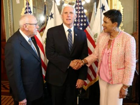 United States Vice President Mike Pence (centre) greets Audrey Marks, Jamaica's ambassador to the US  as she arrives for the swearing-in ceremony of the new US ambassador to Jamaica, Donald Tapia (left), at the White House on Tuesday.