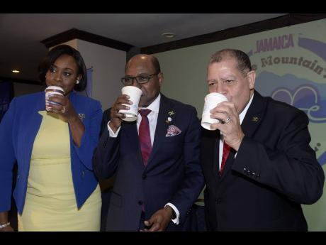 Juliet Holness (left), member of parliament for St Andrew East Rural; Edmund Bartlett (centre), minister of tourism, and Audley Shaw, ministry of industry, commerce, agriculture and fisheries, sip their coffee at the launch of the Jamaica Blue Mountain Coffee Festival held at The Jamaica Pegasus hotel, New Kingston, in  January 2019.