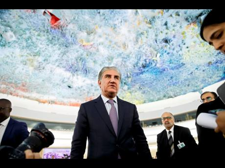 Pakistan's Foreign Minister Shah Mehmood Qureshi leaves after a statement during the 42nd session of the Human Rights Council at the European headquarters of the United Nations in Geneva, Switzerland, Tuesday, September 10, 2019.