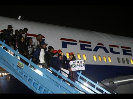 Nigerian returnees from South Africa who left because of recent violence targeted at foreigners arrive on an Air Peace airline at the Murtala Muhammed International Airport in Lagos, Nigeria, on Wednesday, September 11, 2019.