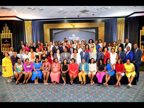 Sagicor Life Jamaica top financial advisers who were fêted by the company last week.