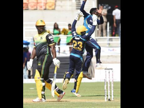 Ian Allen/Photographer Members of the Barbados Tridents team celebrate the dismissal of Jamaica Tallawahs batsman Dwayne Smith during a Caribbean Premier League (CPL) match on September 15. The Tallawahs won by four wickets.