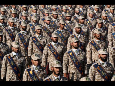 Iranian Revolutionary Guard troops attend a military parade marking the 39th anniversary of the start of Iran-Iraq war, in front of the shrine of the late revolutionary founder, Ayatollah Khomeini, just outside Tehran, Iran, on Sunday.