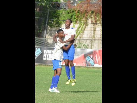 Cumberland High School players celebrating a goal against St George's College at Winchester Park in last season's ISSA/Digicel Manning Cup competition.