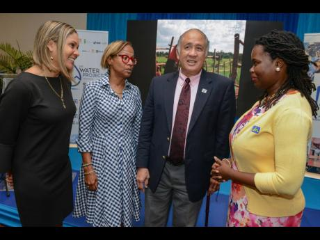 Onyka Barrett Scott (right), general manager of the JN Foundation, in conversation with (from left) Leesa Kow, deputy managing director, JN Bank; Therese Turner-Jones, general manager and country representative for Jamaica at the Inter-American Development Bank; and Parris Lyew-Ayee, chairman of the JN Foundation, at the launch of the Rainwater Harvesting and Grey Water Recycling Training to Developers programme at The Jamaica Pegasus hotel recently.
