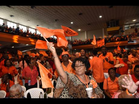 Peoples' National Party supporters enjoying the proceedings during the party's annual conference at the National Arena yesterday.