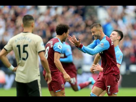 West Ham's Andriy Yarmolenko (right) celebrates after scoring his side's opening goal during their English Premier League match against Manchester United at London Stadium in London, England, yesterday.