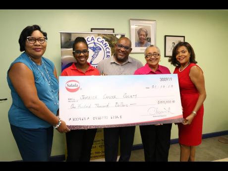 From left: Dianna Blake-Bennett, general manager at Salada Foods Jamaica and Tamii Brown, commercial and corporate affairs manager at Salada Foods Jamaica present the symbolic cheque to Michael Leslie, finance manager at JCS; Carolind Graham, president of Jamaica Reach to Recovery; and Yulit Gordon, executive director at JCS.