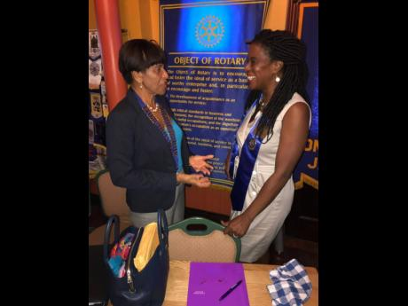 Rotary District Governor Delma Maduro (left) is all smiles as she encourages president Yemima Garcia during a visit with Rotary Clubs in Montego Bay.