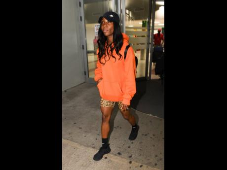 Shelly-Ann Fraser-Pryce arriving at the Norman Manley International Airport in Kingston last night after winning two gold medals at the 2019 IAAF World Championships in Doha, Qatar. See related stories in Section B.