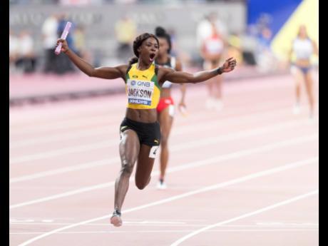 Shericka Jackson anchoring the Jamaica women's 4x100m relay team to gold at the IAAF World Championships held at the Khalifa International Stadium in Doha, Qatar, on Saturday.