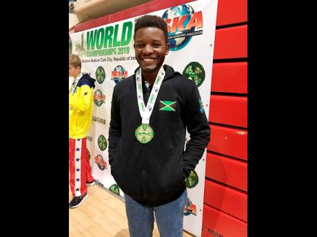 Jamaica's heavyweight, Richard Stone, beams after completing a double-gold performance at the International Sports Kickboxing Association (ISKA) Amateur Members Association World Championships at the Neptune Stadium in Cork City, Ireland, on Friday.