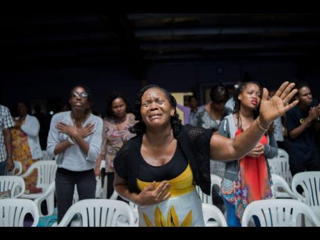 Worshippers at the inaugural National  Prophetic Summit at the Emmanuel Apostolic Church in Portmore, St Catherine. Lyston says some will receive the word of God with joy, but will retreat when being persecuted.