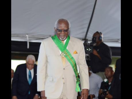 Dr Julius Garvey walks away after being conferred with the Order of Jamaica for universal civil activism and the promotion of entrepreneurship and the legacy of Garveyism and pan-Africanism.
