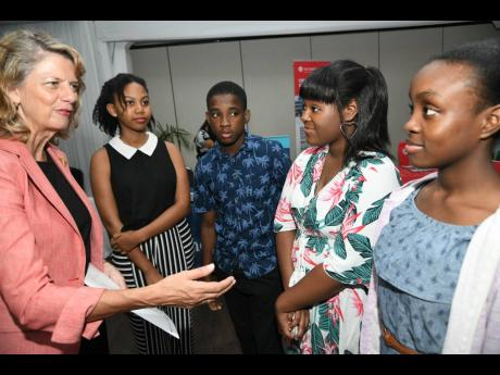 Laurie Peters (left), Canadian high commissioner to Jamaica, in discussion with students (from second left) Olivia Duncan, Corey Douglas, Arielle Aubrons and Jade Mullings. Peters and the students were attending the 2019 EduCanada, Fair which was officially launched at the Spanish Court Hotel in Kingston on Sunday, November 3, 2019.