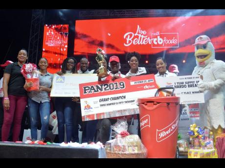 PAN 2019 sponsors congratulate Kerisa Wright, on her victory. From left are Alecia Forbes (Walkerswood), Jodi-Ann Cohen (Red Stripe), Laurel Whyte, Richard Johnson and Sanya Wallace (JN Group), Kerisa Wright, Nicole Hall (CB Foods), Omega Harris (National Baking Company) and the CB mascot, 'Chikky'.