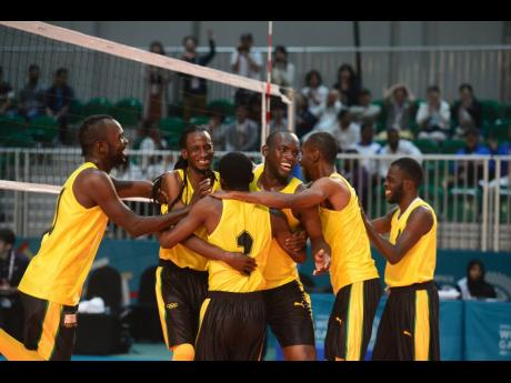 Members of the Special Olympics Jamaica volleyball team celebrate after defeating Japan by two sets to one to capture the gold medal in the event at the Special Olympics World Summer Games in Abu Dhabi, United Arab Emirates, on Wednesday, March 20, 2019.