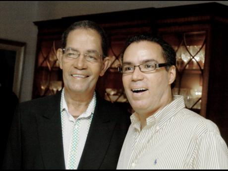 Douglas Vaz is seen here with his son, Daryl, in a February 19, 2010, Gleaner photograph. File