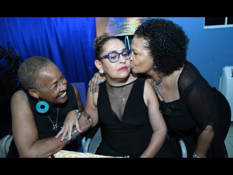 Berl Francis (left) and Maxine Brown (right) greet Hilary Wehby at the launch of Wehby's book 'My New Normal: Reflections of a Stroke Survivor' earlier this year.