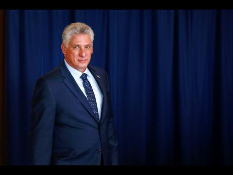 FILE - In this Sept. 26, 2018 file photo, Cuba's President Miguel Diaz-Canel arrives for a meeting with the United Nations secretary-general, on the sidelines of the 73rd session of the U.N. General Assembly, at U.N. headquarters. Díaz-Canel is making his first trip to the town of Caimanera, the closest point in Cuba to the U.S. naval base at Guantanamo Bay. He arrived on Thursday morning, Nov. 14, 2019. (AP Photo/Jason DeCrow, File)