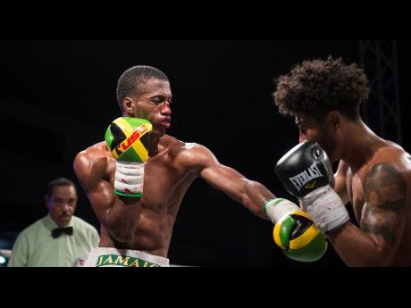 Toriano Nicholas (left) of Jamaica faces Carlos Dixon of the United States in the fifth bout at the Gloves Over Guns Fight Night held at the Ambassador Theatre in Trench Town, Kingston, on Saturday, July 13, 2019.