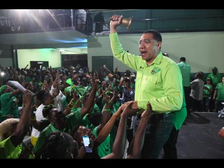 Prime Minister and leader of the Jamaica Labour Party (JLP) Andrew Holness rings the bell at a JLP West Kingston constituency conference held last evening at the Tivoli Gardens Community Centre.