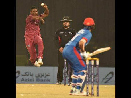 Windies pacer Sheldon Cottrell (left) mid-stride during their third and final Twenty20 International match against Afghanistan at the Atal Bihari Vajpayee International Stadium in Lucknow, India, yesterday.