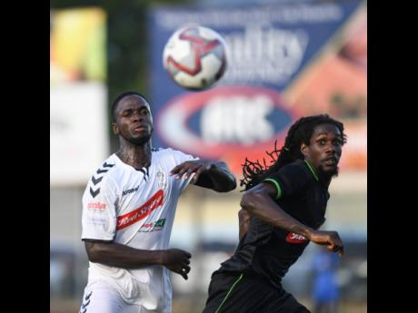 UWI's Tejaun Wilson (left) challenges Molynes United's Japhe Dixon during a Red Stripe Premier League at the Drewsland Stadium on Sunday, September 8, 2019.