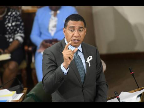 Prime Minister Andrew Holness speaking during yesterday's parliamentary sitting at Gordon House in Kingston.