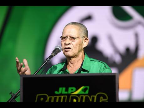 Former Prime Minister Bruce Golding addresses Jamaica Labour Party supporters during the party's annual conference, held at the National Arena on Sunday.