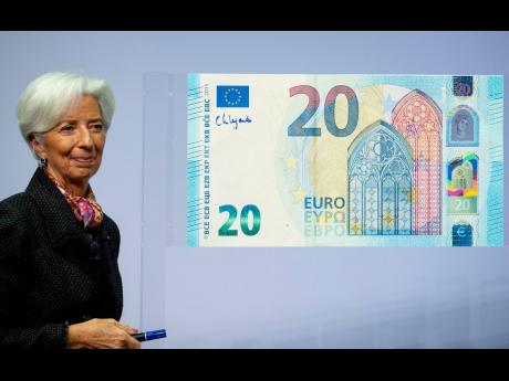 The new President of the European Central Bank Christine Lagarde adds her signature to an oversized euro banknote at the ECB in Frankfurt, Germany, on Wednesday, November 27, 2019.