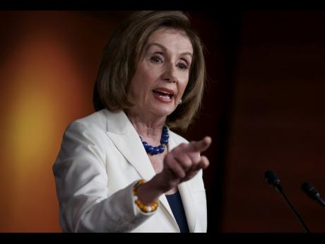 House Speaker Nancy Pelosi responds forcefully to a question from a reporter at a press briefing at the Capitol in Washington on Thursday.