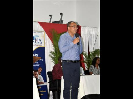 Health Minister Dr Christopher Tufton addressing a town hall meeting in Negril, Westmoreland, on Thursday. Dengue was among the issues discussed.