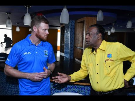 Cricket West Indies (CWI) Cricket Education Manager Chris Barbazon (left) and Jamaica Cricket Association president Wilford 'Billy' Heaven have a quick chat in-between session, at the CWI Level Two coaching course at Sabina Park recently.