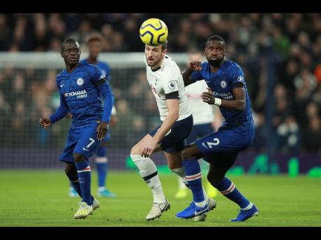 Tottenham's Harry Kane (centre) and Chelsea's Antonio Rüdiger (right) chase after the ball during their English Premier League match at the Tottenham Hotspur Stadium in London, England, yesterday.