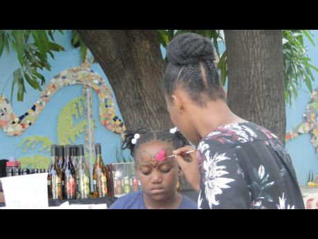 A child getting her face painted at Pre-Kwanzaa Fest, held on the Liberty Hall compound at 76 King Street, Kingston, on Saturday, December 21.