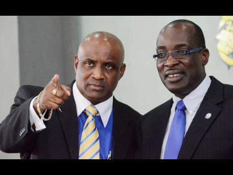 Caribbean Maritime University President Fritz Pinnock (left) and then principal of Jamaica College, Ruel Reid, in November 2011. The headmaster-turned-education minister was sacked last year amid corruption allegations.