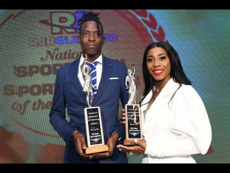National Sportsman of the Year 2019 Tajay Gayle and Sportswoman of the Year 2019 Shelly- Ann Fraser-Pryce pose with their trophies at the RJRGLEANER Sports Foundation awards function, which was held at The Jamaica Pegasus hotel in New Kingston last Friday night.