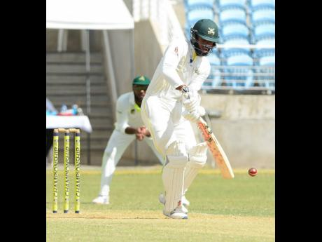 Jamaica Scorpions batsman John Campbell on the go during his 101 against the Windward Islands Volcanoes at Sabina Park yesterday.