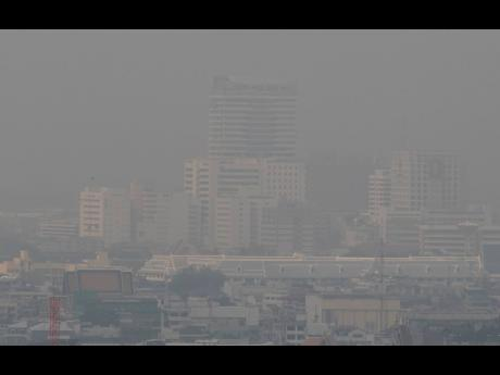 A thick layer of smog covers central Bangkok, Thailand, on Monday, sending air pollution levels soaring to 89 micrograms per cubic metre of PM2.5 particles in some areas, according to the Pollution Control Department.