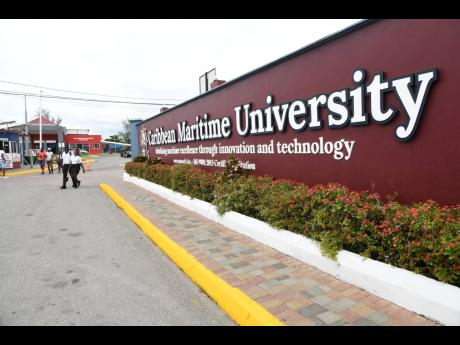 Caribbean Maritime University students exit the east Kingston campus on Monday.