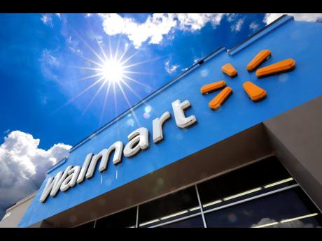 This June 25, 2019 file photo shows the entrance to a Walmart in Pittsburgh. Walmart is reporting  disappointing fourth-quarter profits and sales. The nation's largest retailer says that sales at its US stores heading into the holiday season were weaker than expected. It also said that social unrest in Chile hurt its business.